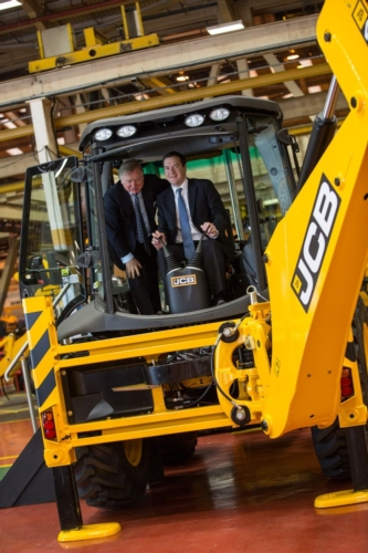 lord-bamford-left-with-the-chancellor-in-the-cab-of-a-jcb-backhoe-loader